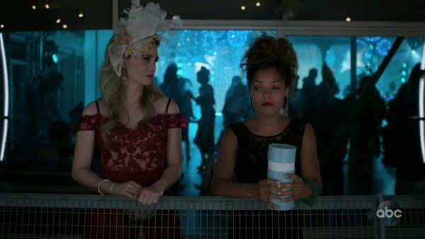 Morgan and Claire at a drag show, dumping Breeze's ashes.