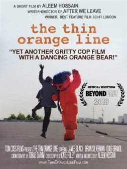 A man and a orange bear dancing around.