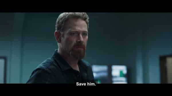 Paul (Max Martini) asking Dr. Horn to save Eli.