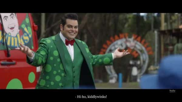 Teddy aka Nathan (Josh Gad) greeting children.