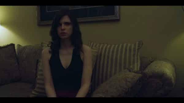 Beth (Elizabeth McCoy) sitting in Tow Truck's home.