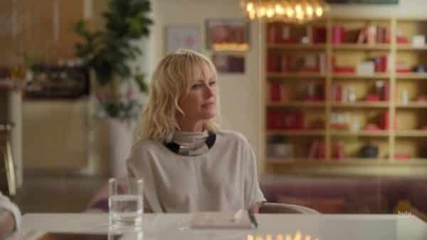 Celeste (Malin Akerman) during a meeting.