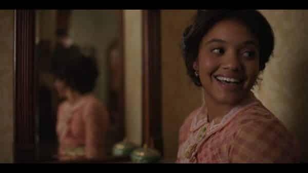 Darling (Kiersey Clemons) smiling over her shoulder.