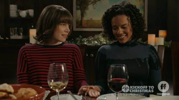 Lydia (Lee Marshall) and Anna (Genelle Williams) smiling.