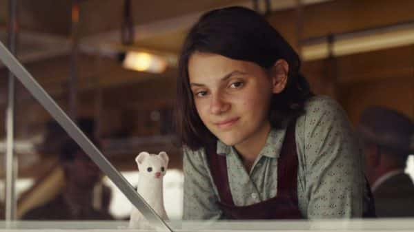 Lyra (Dafne Keen) is our lead and Pan (Kit Connor) is her daemon.
