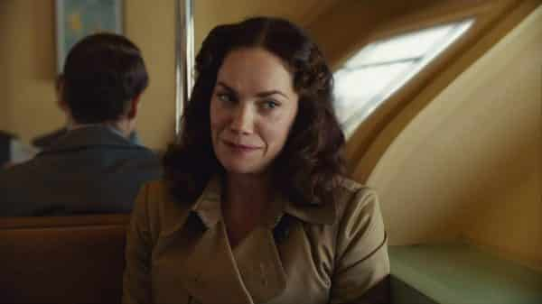 Mrs. Coulter (Ruth Wilson) is a scholar who takes in Lyra as an assistant.