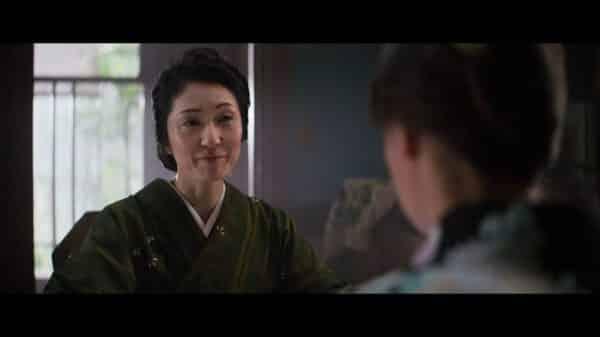 Ms. Katoh (Akiko Iwase) talking to Lucy.