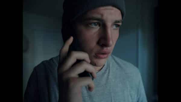 Richie (Tye Sheridan) on the phone.