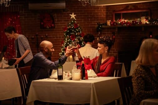 Rush (Romany Malco) and Roxy (Sonequa Martin-Green) having a meal together.