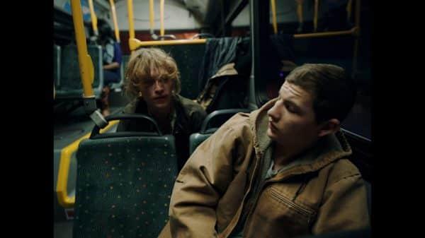 Swim (Caleb Landry Jones) and Richie (Tye Sheridan) on the bus.
