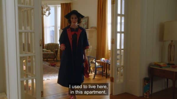 Miriam talking to a woman, living in her former apartment, as she deals with a wave of nostalgia.