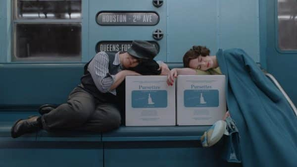 Susie and Miriam sleeping on boxes of tampons, on the subway.