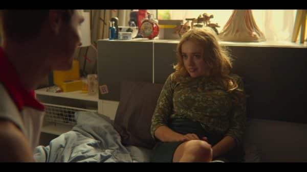 Aimee sitting on Steve's bed.