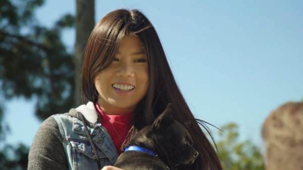 Bailey (Ana Ming Boswtick-Singer) with her dog.