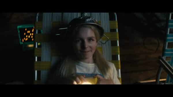 Christmas (McKenna Grace) looking up at the stars.