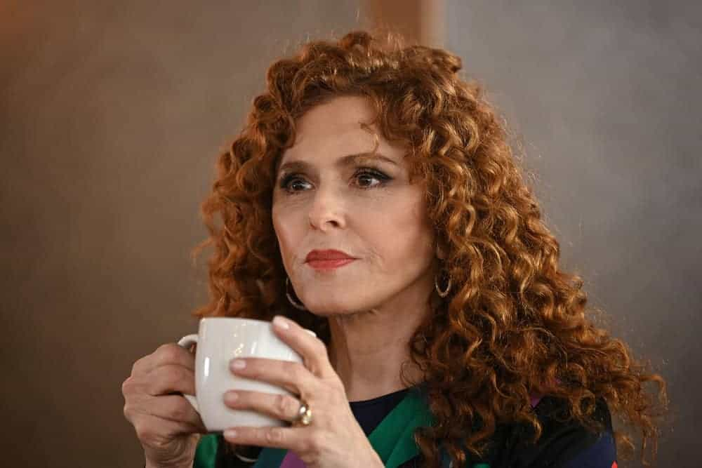 Deb (Bernadette Peters) sipping her tea.