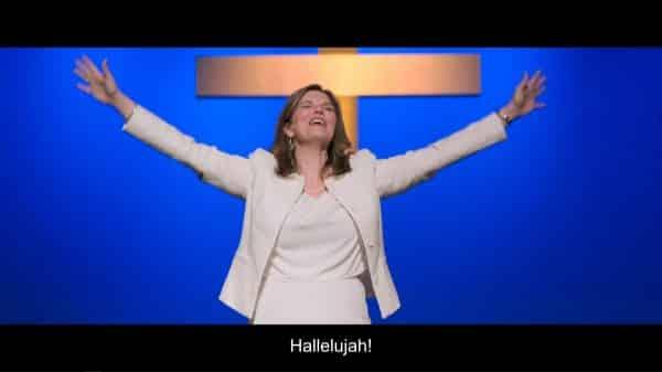 Pastor Helen (Jeanne Tripplehorn) shouting Hallelujah.