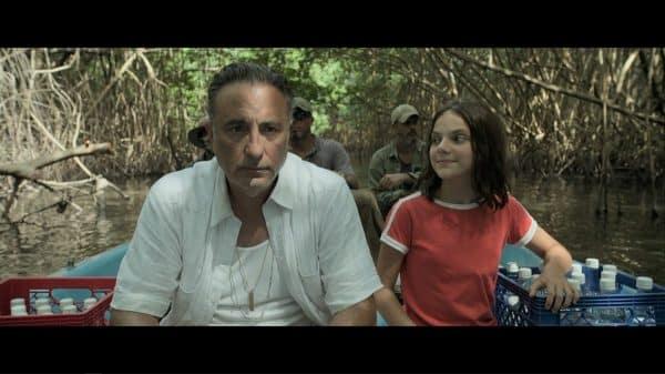 Rafa (Andy Garcia) and Ana (Dafne Keen) on a river.