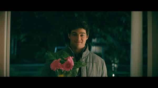 Peter (Noah Centineo) holding flowers for Lara Jean.