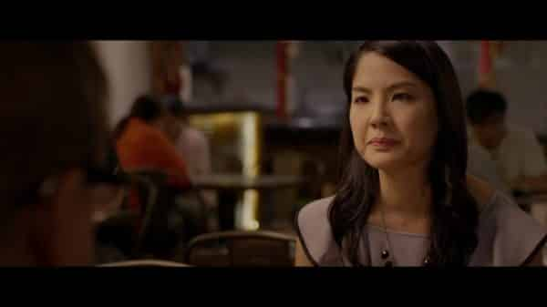 Carol (Lynn Chen) looking dismayed.