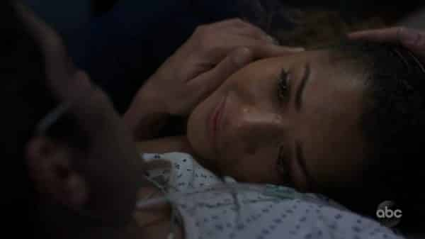 Claire resting on Dr. Melendez's chest as he lays dying.
