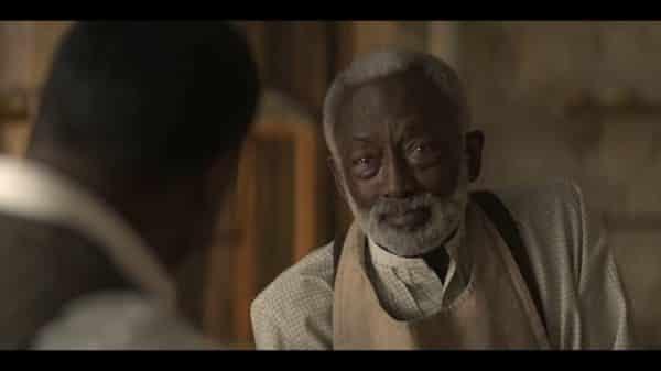 Cleophus (Garrett Morris) talking to his son.