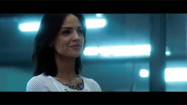 KT (Eiza Gonzalez) as Ray is introduced to everyone.