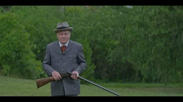 Mr. Rockefeller (Frank Moore) taking a break from shooting.