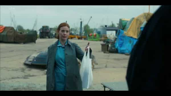 Winnie (Amy Nuttal) bringing food to Carl.