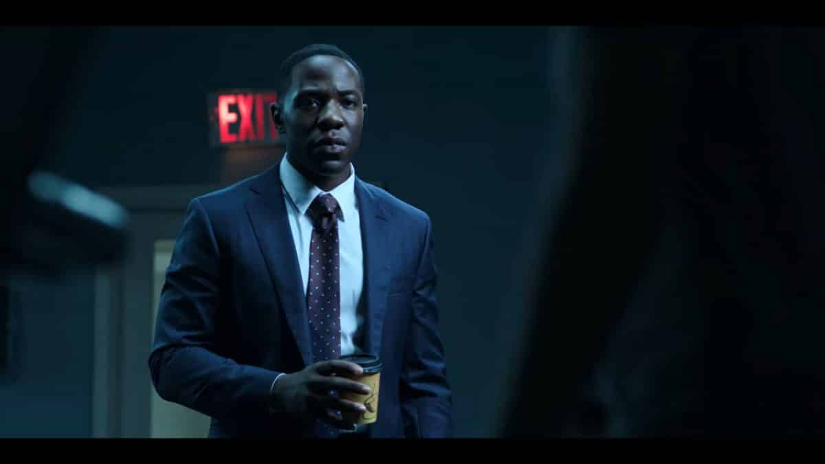 Agent Trevor Evans (McKinley Belcher III) with Agent Petty in a FBI gym.