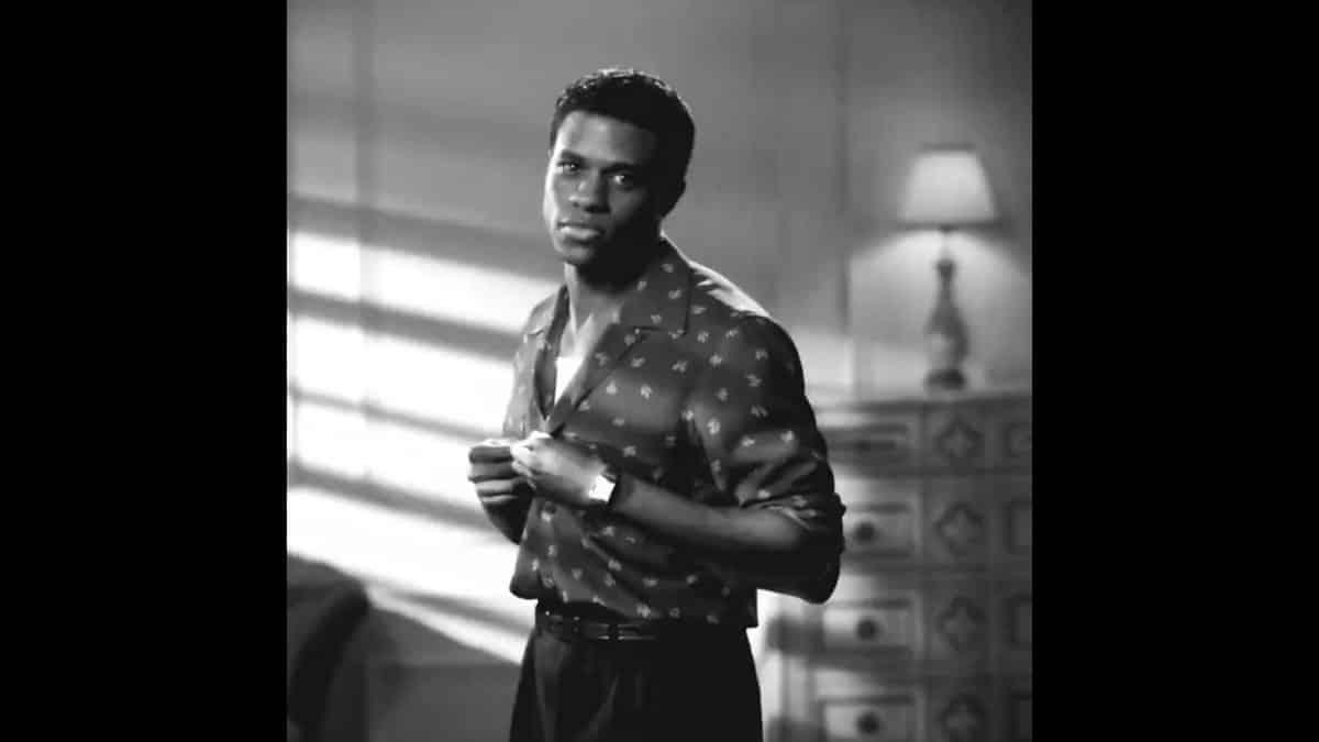 Archie Coleman (Jeremy Pope) unbuttoning his shirt.