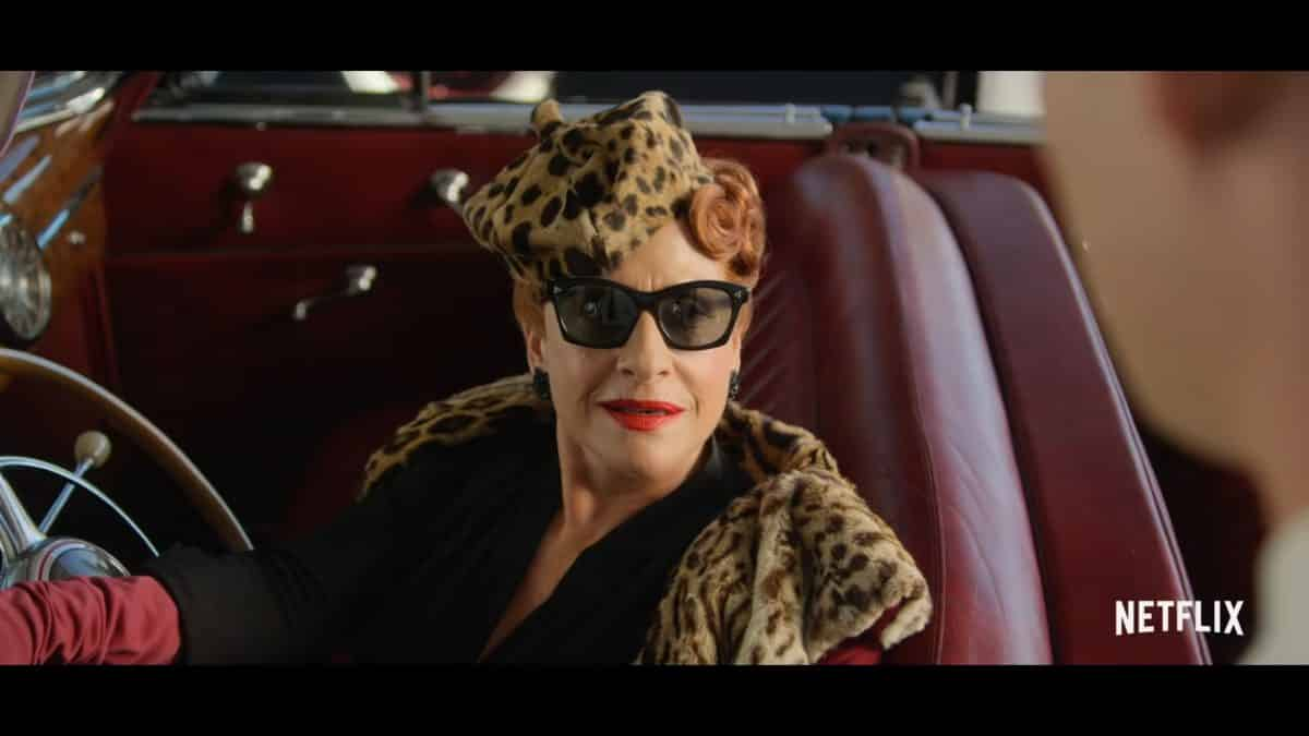 Avis Amberg (Patti Lupone) pulling up in her car.