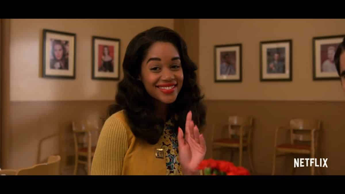 Camille Washington (Laura Harrier) smiling and waiving.