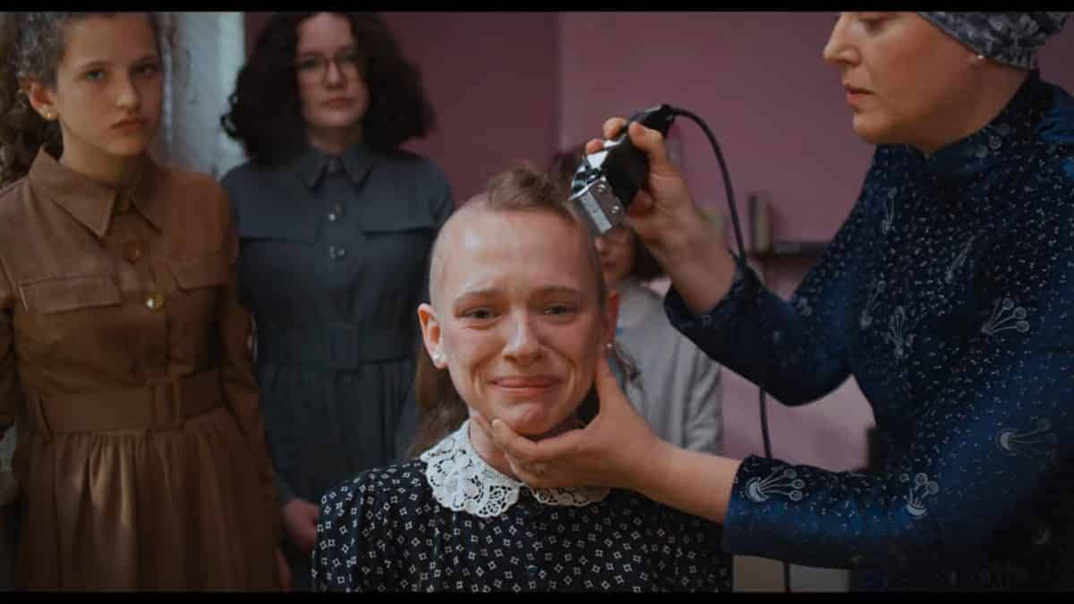 Esty having her hair cut off.