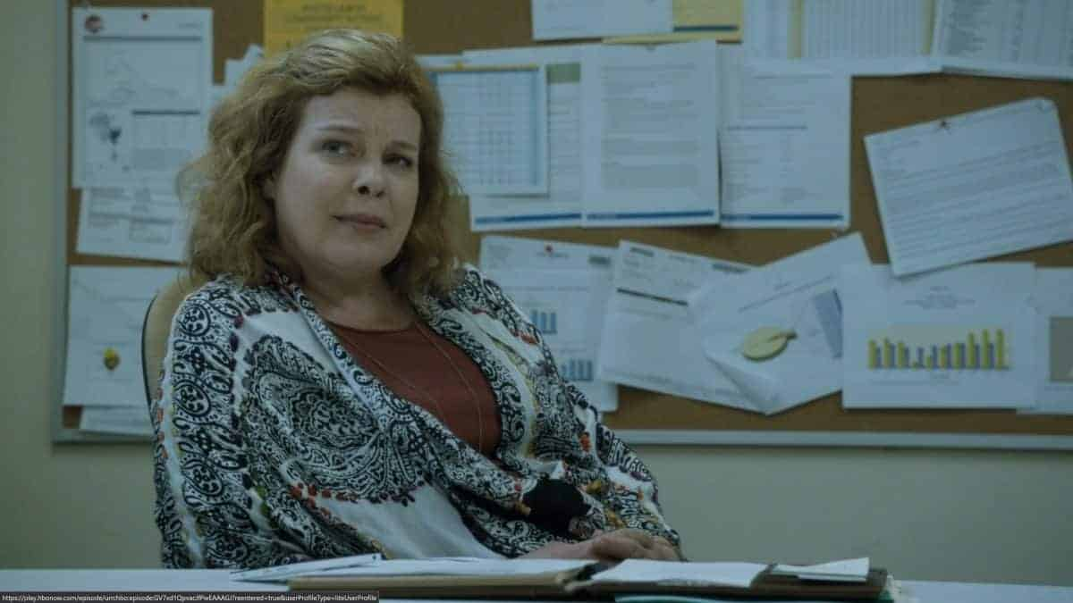 Joanne (Catherine Curtin) listening to a presentation.