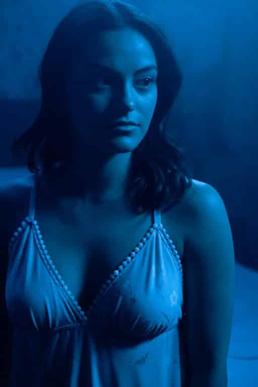 Katie (Camila Mendes) in her evening sleeping clothes.