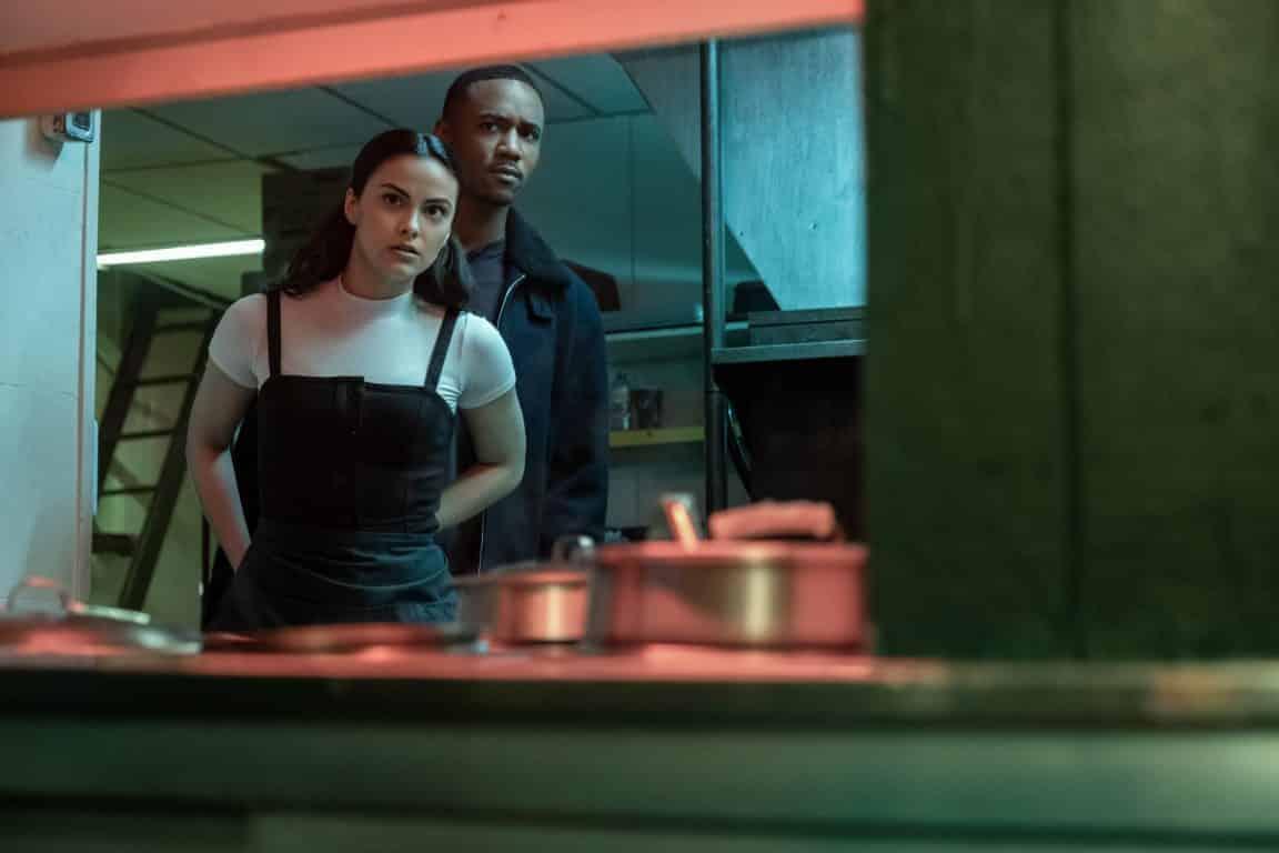Katie (Camila Mendes) and Adam (Jessie T. Usher) in a restaurant kitchen.