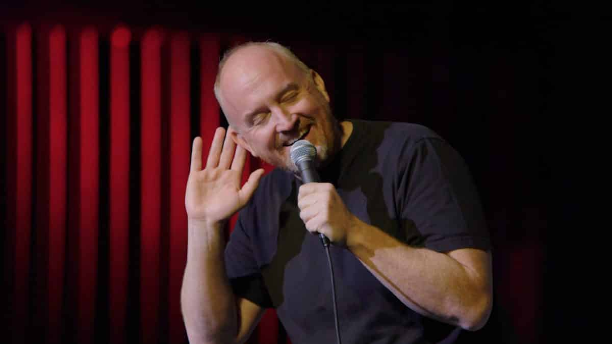 Louis CK absorbing the reaction of the audience.