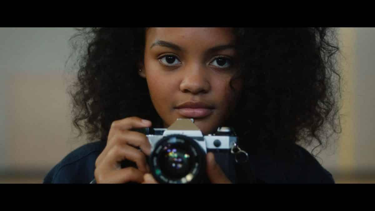 Paloma (Celeste O'Connor) with her signature camera.