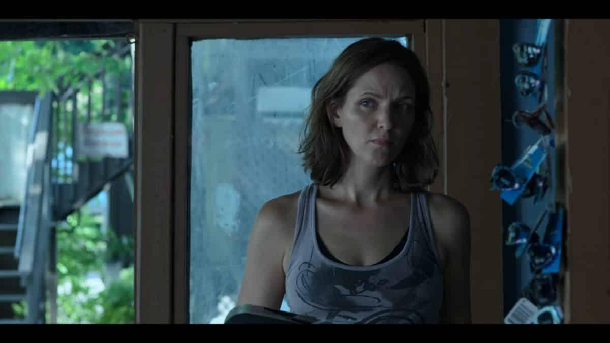 Rachel Garrison (Jordana Spiro) in the lodge lounge area.