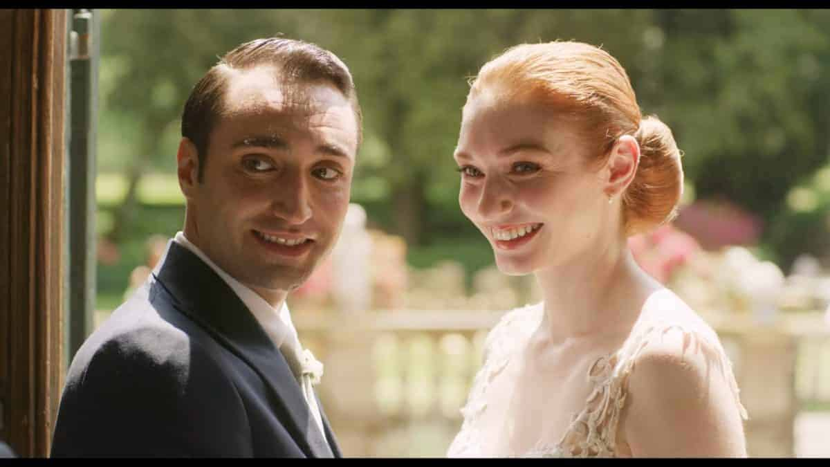 Roberto (Tiziano Caputo) and Hayley (Eleanor Tomlinson) smiling for photos.