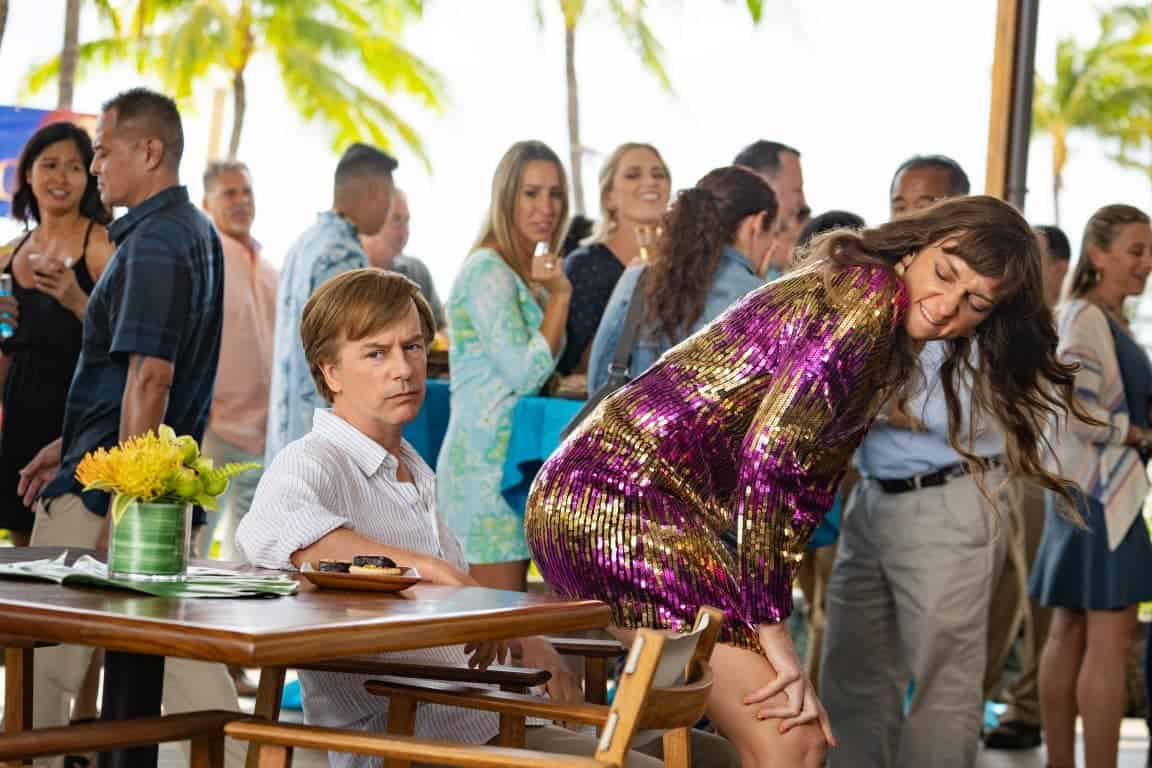 Tim (David Spade) looking annoyed as Missy (Lauren Lapkus) gives him a lapdance.