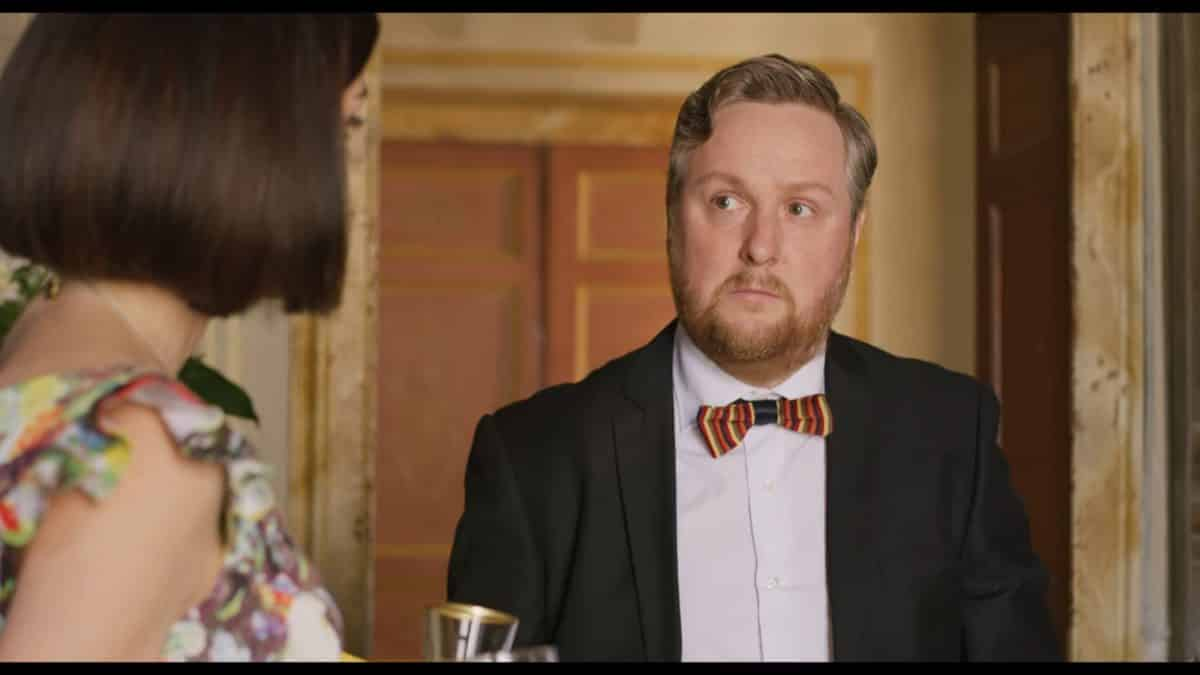 Tim Key as Sidney talking to Cristina.