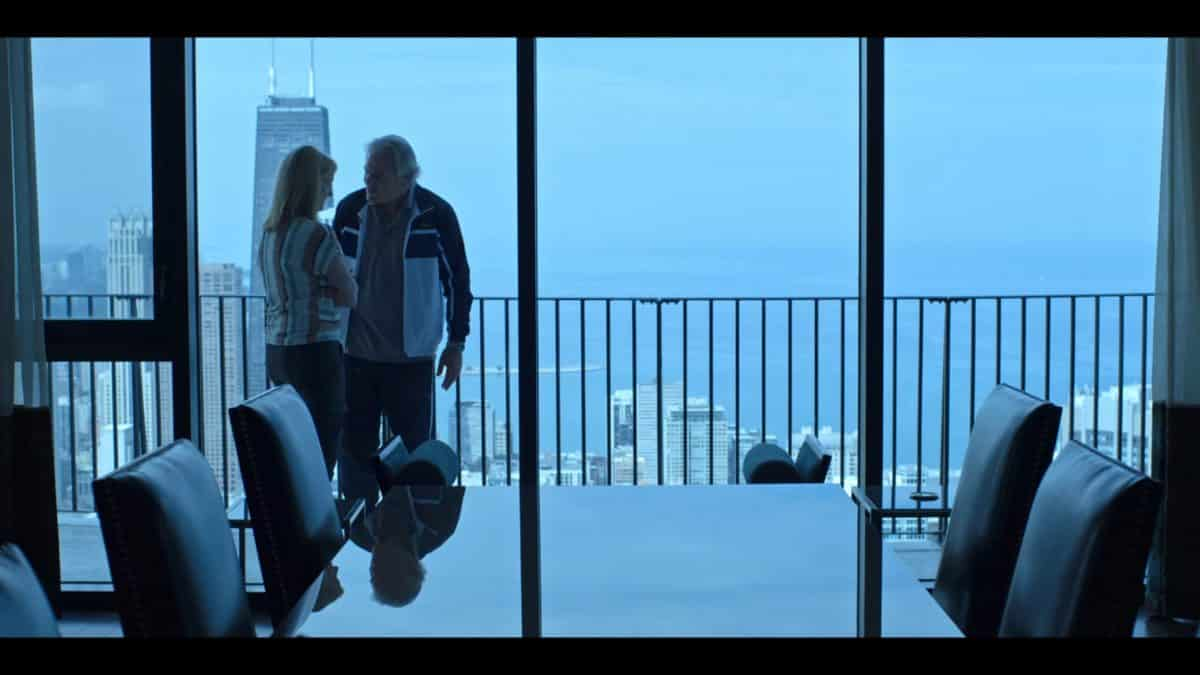 Wendy and Gary (Bruce Altman) out on a balcony.