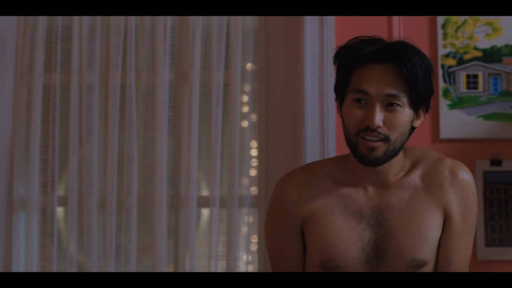 Augie (Jin Ha) with his shirt off.