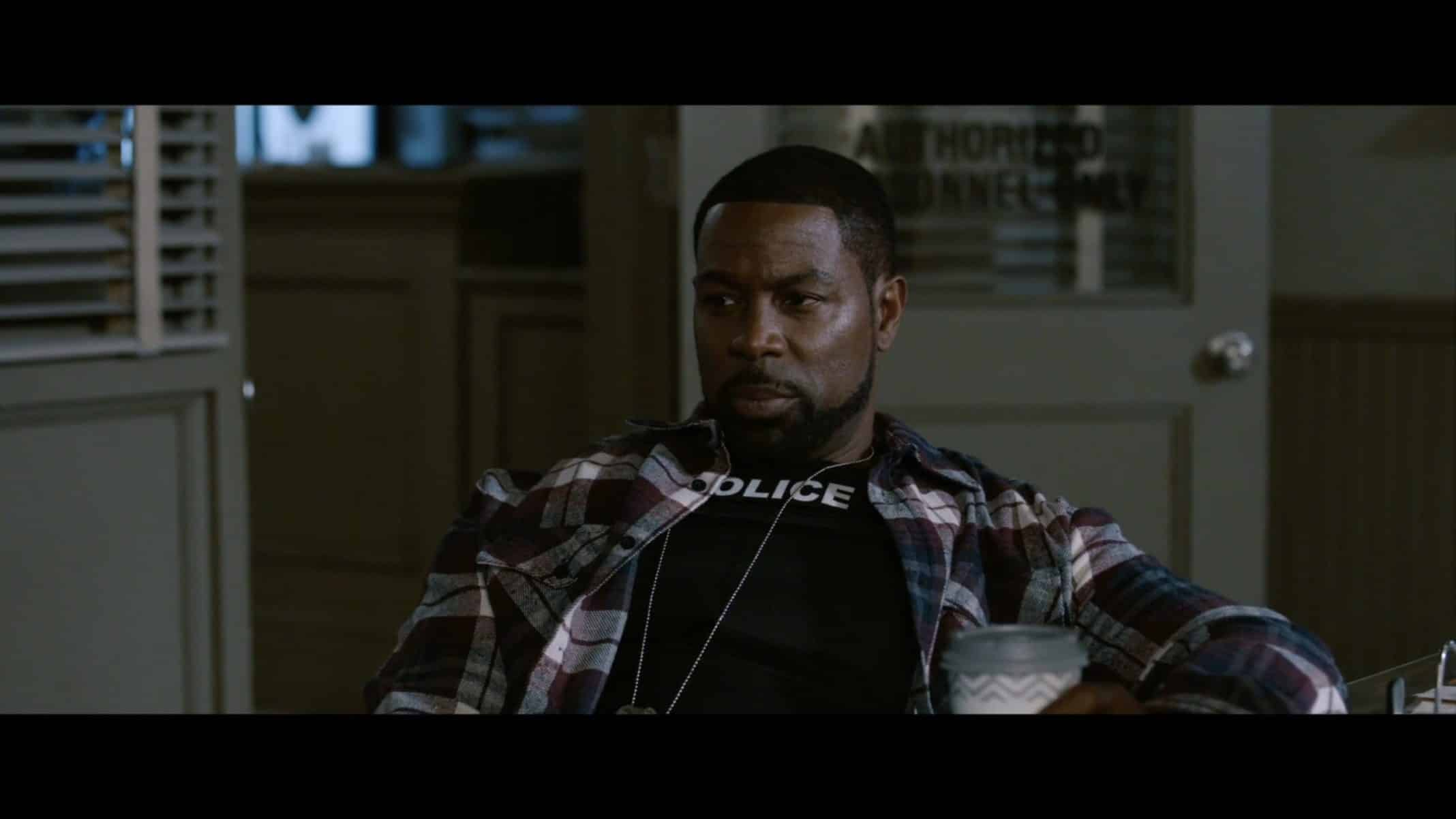 Detective Ryan (Darrin Dewitt Henson) at the police precinct.