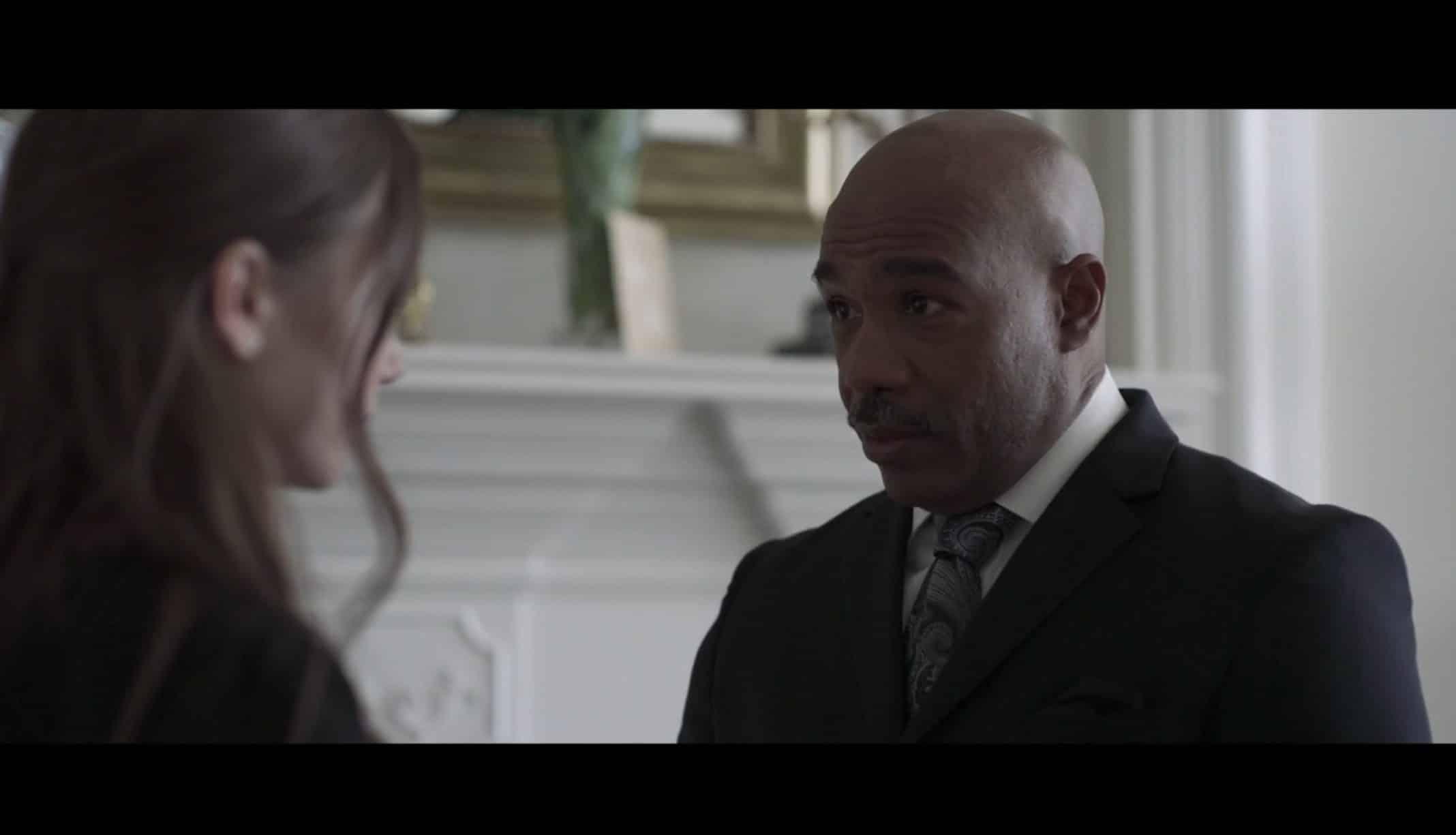 Harold (Michael Beach) having a private conversation with Lauren.