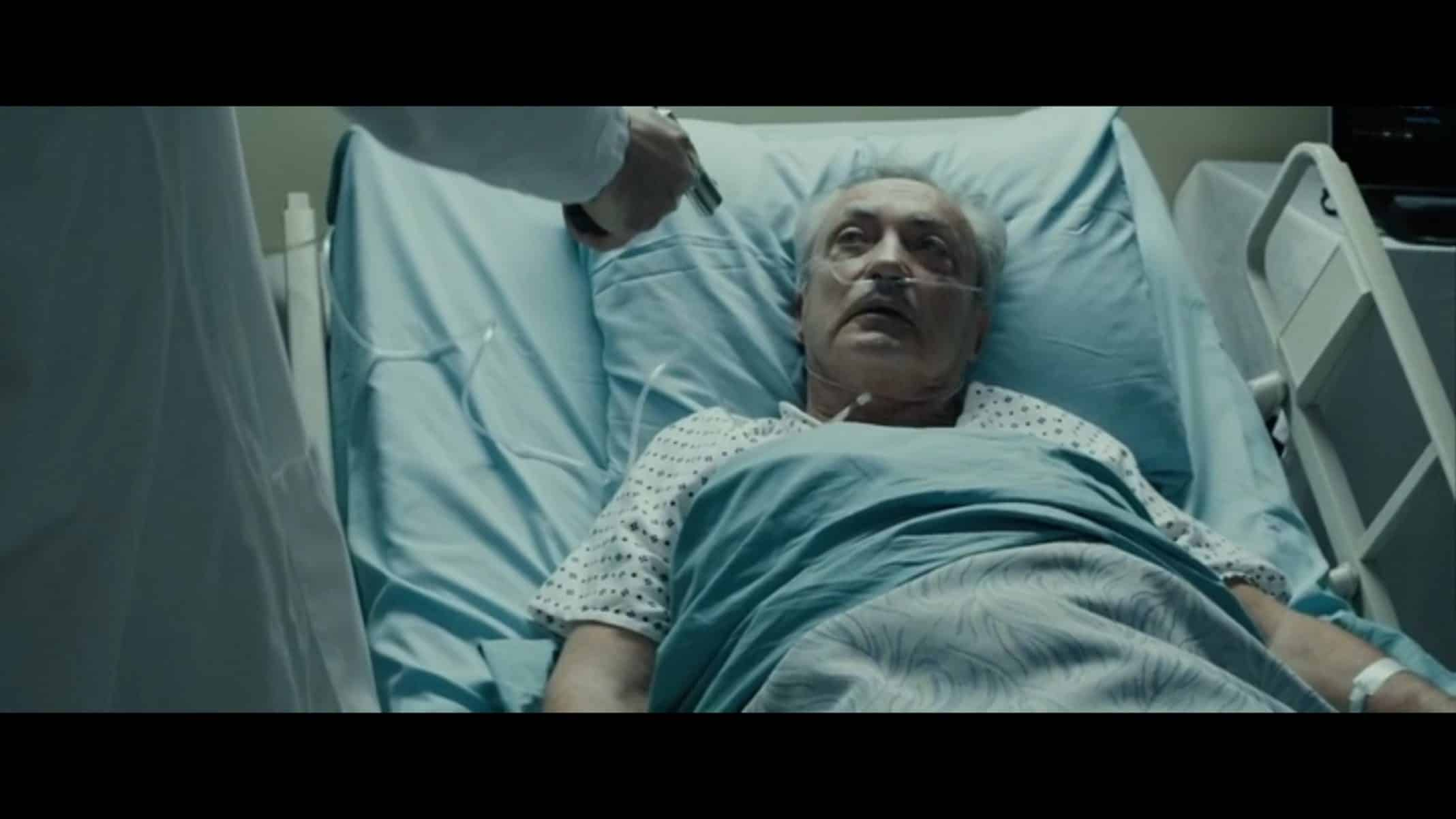 Ivan (Udo Kier) in a hospital bed.