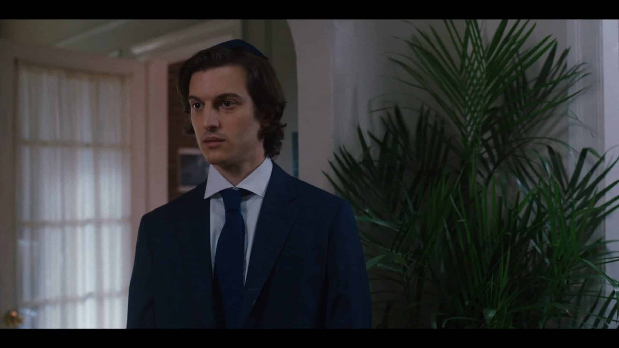 Jim (Peter Vack) getting ready for a family event.
