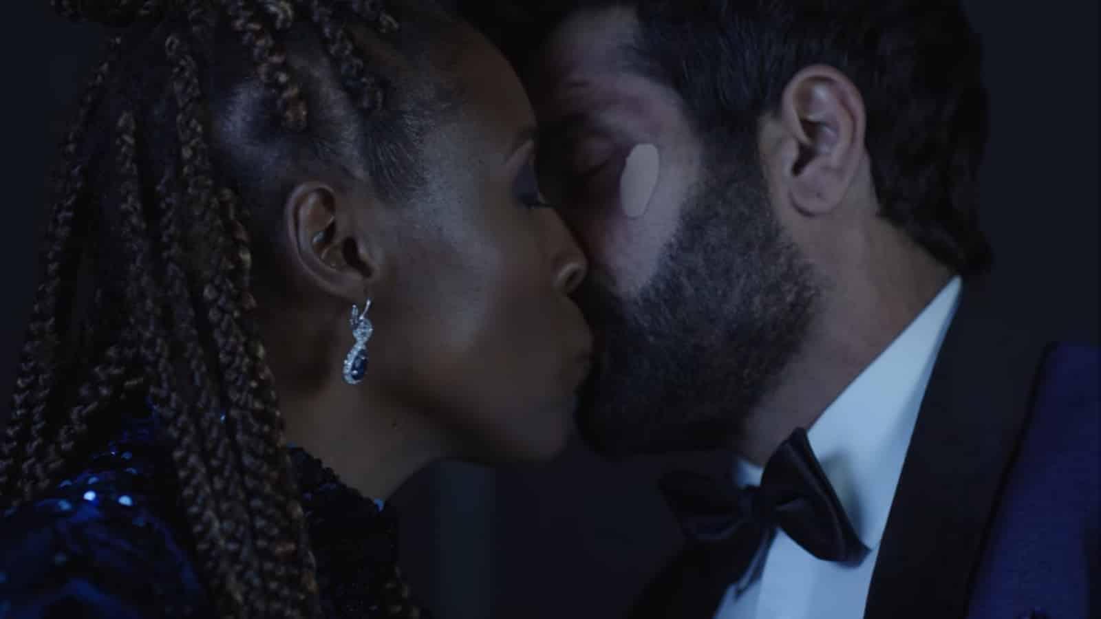 Leilani and Jibran kissing.